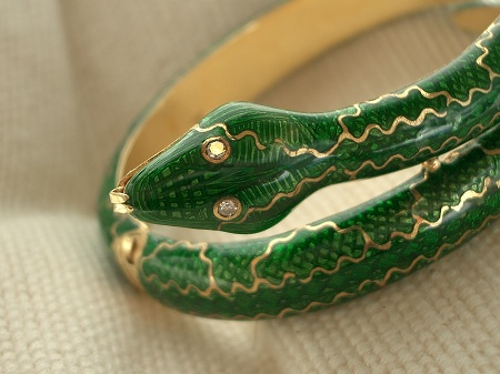 Green enamel snake bracelet with diamond eyes