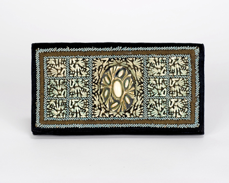 Black silk pochette faced with carved ivory, 1920s